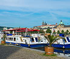 A view of Prague Castle and boats
